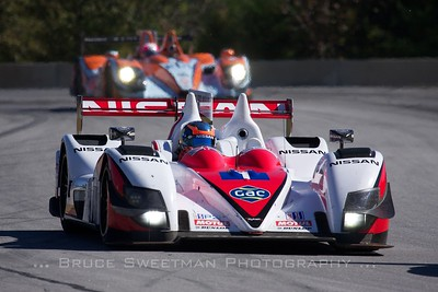 The Greaves Motorsports Zytek Z11SN leads the Oak Racing Morgan through turns 3 and 4.