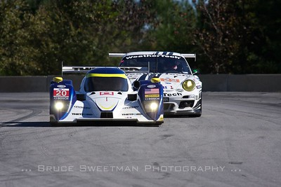 Mixing classes: The (P1) Dyson Racing Lola B12/60leads the #22 (GTC) Alex Job Racing 911 GT3 Cup Porsche.