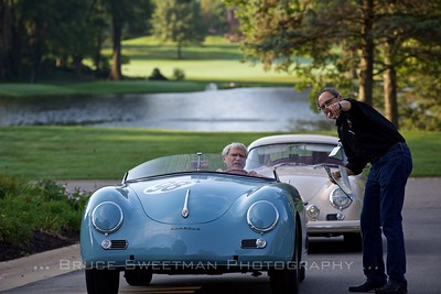 Gerald McCormick gets directions from  concours organizer Myron Vernis on where to park his in his 1957 Speedster.