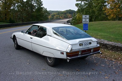 Lawrence Wagg of Lafayette, Colorado pulls the museum's 1973 Citroën SM onto the Natchez Trace Parkway.