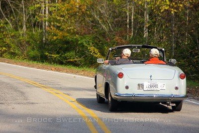 The museum's 1954 Simca Weekend glides along.