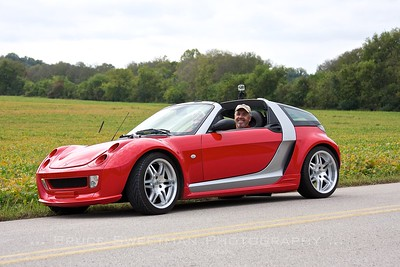 David and Lyn Berelsman of Celebration, Florida in the musuem's 2006 Smart Roadster. 3