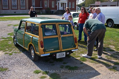 The museum's 1967 Morris Mini Minor Traveller draws a small crowd in Mount Pleasant, TN.
