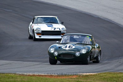 1963 Jaguar E-type - Johan Woerheide leads 1971 Datsun 240Z - Austin Jabaley through Turn 12.