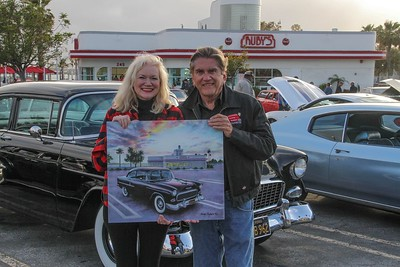 Morgan Kari with owner Jerry Mull with painting of his 1955  Chevy Deray