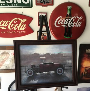 Morgan's painting of his  Challenger is on display in Jerry's fantastic garage.