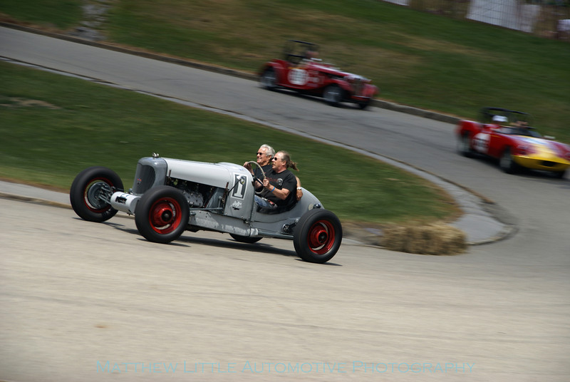 "The marvelous 1935 Reuter Special ""Old Gray Mare"" rounding turn 13 during the charity rides."