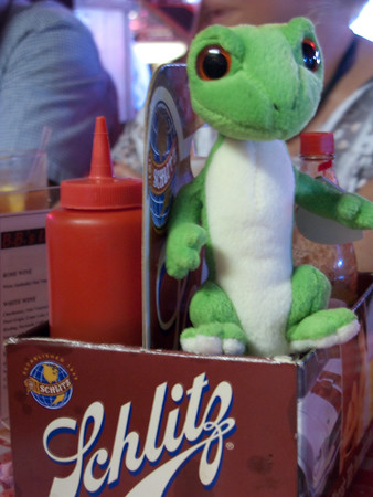 Gus at the dinner table watching over Terry's Ketchup bottle.