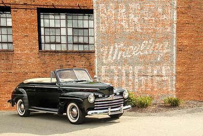 1946 Ford Super Deluxe and Marsh Wheeling Stogies sign, Wheeling, WV.