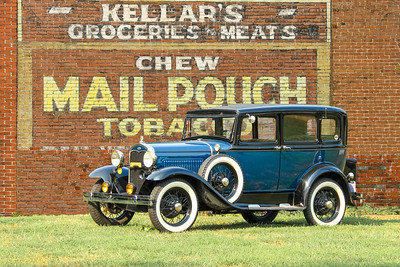 1931 Ford Slant Window Sedan and Mail Pouch Tobacco sign, Butler, PA.