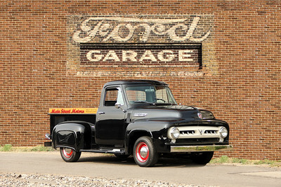 1953 Ford F100 Pickup and Ford sign, Johnsonburg, PA