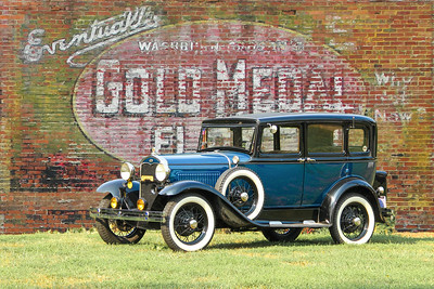 1931 Ford Model A Slant Windshield Sedan and Gold Medal Flour sign, New Kensington, PA. .
