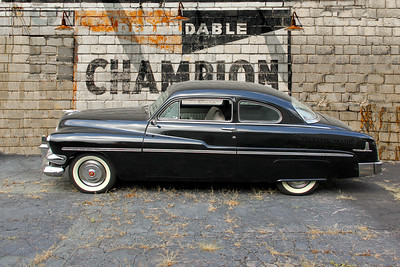 1951 Mercury Coupe and Champion Spark Plugs sign, Mt Lebanon, PA.