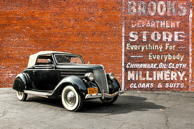 1936 Ford Club Cabriolet and Brooks Department Store sign, Monessen, PA.