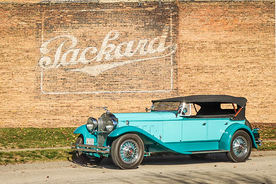 1930 Packard 734 Speedster Phaeton and Packard sign, Cleveland, Ohio.