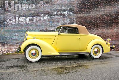 1937 Packard 115C and Uneeda Biscuit sign, Lexington, KY.