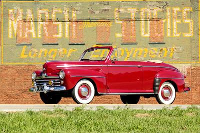 1948 Ford Super Deluxe and Marsh Wheeling Stogies sign, Wheeling, WV.