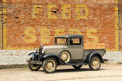 1930 Ford Model A Closed Cab Pickup and Feed and Seeds sign, Wheeling, WV.
