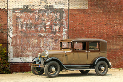 1928 Ford Model A Leatherback Sedan and Tom Tucker sign, Springdale, PA.