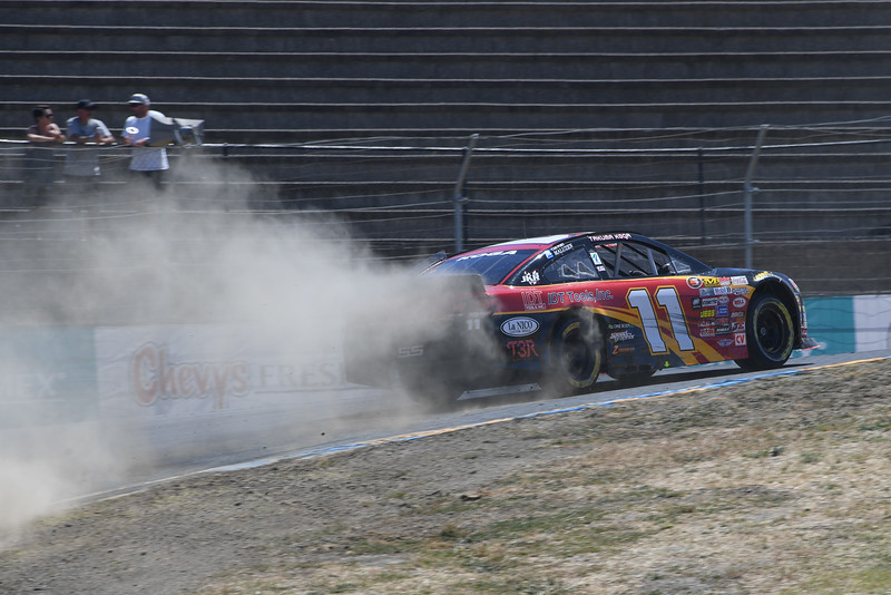 #11 Takuma Koga leaves a trail of dust at turn 2 at Sonoma Raceway
