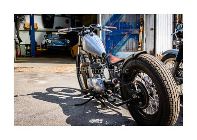 Triumph Bobber Custom looking into Workshop Seventy7