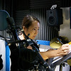 Rae writes some notes before she records audio for The Qiu Jin Project.