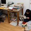 Rae assembles the books she will be returning the Berkeley libraries.