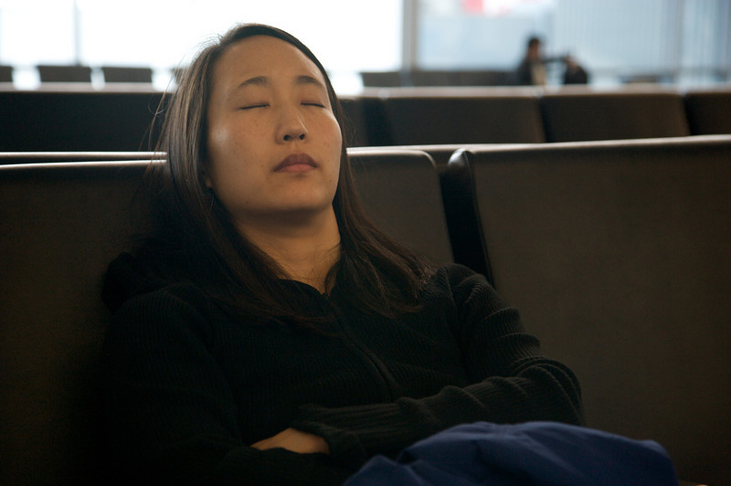 Rae tries to get some sleep at SFO.
