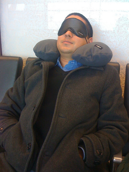 JP gets comfortable with his neck pillow and eye mask