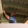 Jerry gets ready to attach the wall to our garage beam.