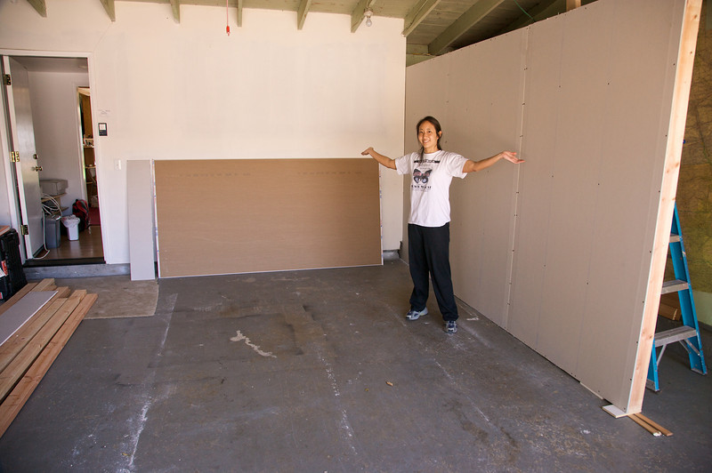 Rae stands in front of one wall of our set.