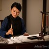 Qiu Jin writing calligraphy