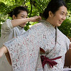 Yuki helps Angela with her kimono and obi.