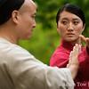 Qiu Jin and her relative pushing hands