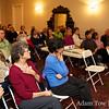 Audience members listen during Rae's presentation.