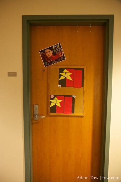 Advertisement for Autumn Gem on Jeni's dorm room door.
