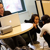 Getting things ready for the screening. Adam on the computer and Rae talking with Carmen from the BCNC. Photo Credit: Anh Dao Kolbe