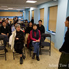 Rae answers questions from the crowd following the screening at the Boston Chinatown Neighborhood Center.