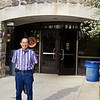 Uncle Don stands in front of the entrance to the Donald D. Warner Student Life Center at Brookdale Community College.