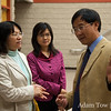 Prof. Zhang speaks with his colleagues.