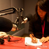 Rae writes notes before the interview.