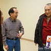 Rae and Don greet Tien-Fang Hou.