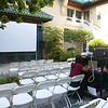 Rae gets in some last-minute emails before the Autumn Gem screening at the Pacific Asia Museum.