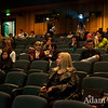 Students, faculty and guests await the start of the film.