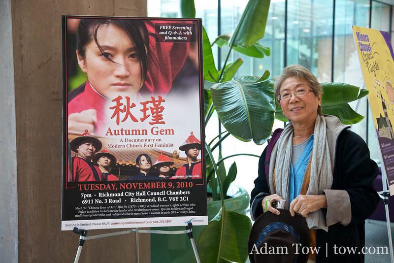 Mrs. Tow in front of the Richmond Autumn Gem poster.