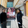 Adam and Rae in front of the Richmond screening poster.
