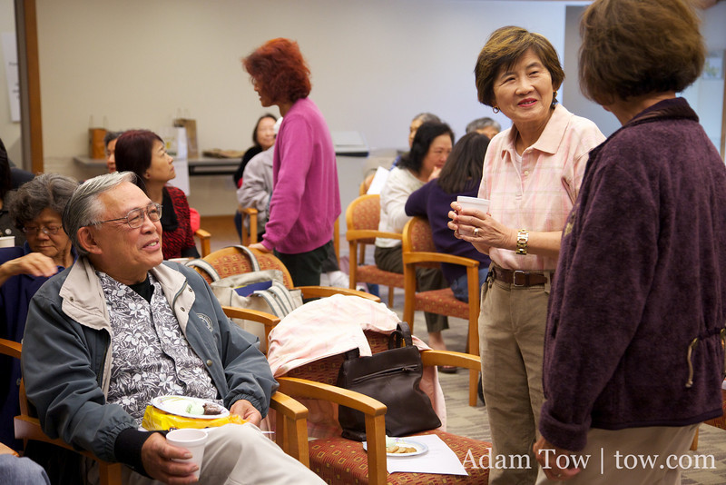 Chi Am Circle club members talk before the Autumn Gem screening at the Saratoga Public Library.