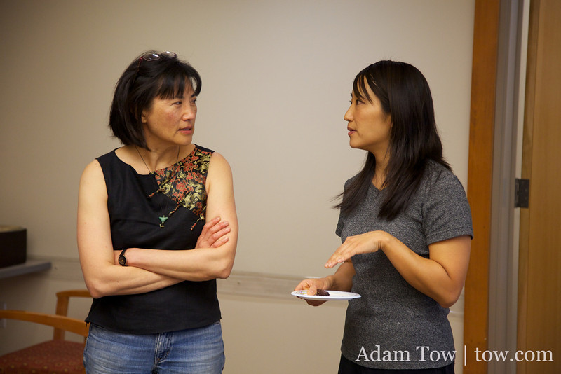 Rae talks with a Chi Am Circle member before the screening.