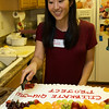 Rae cutting the Qiu Jin Project celebratory cake.
