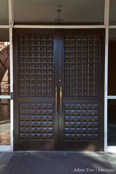 Enter through the double doors.